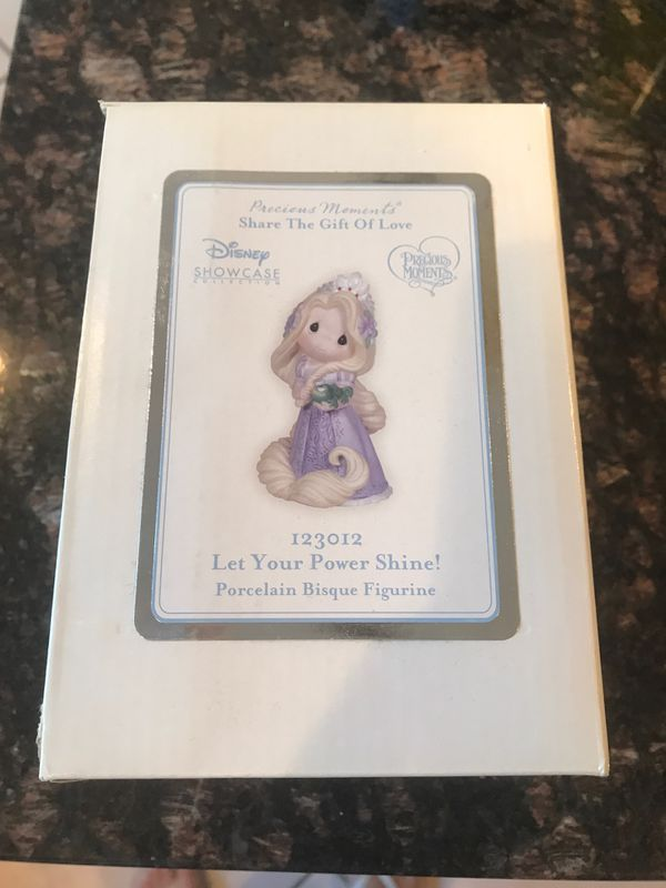 Brand new in box Rapunzel precious moments porcelain figure.