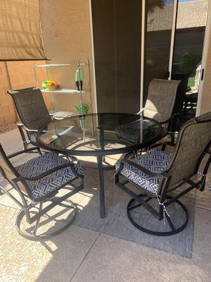 Tinted glass table and 4 swivel chairs for Sale in Gilbert, AZ