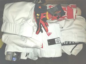 Children's and mens baseball pants brand new with tags, and Under Armour baseball gloves , $10 each item for Sale in Coraopolis, PA