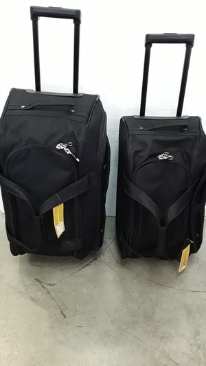 LUGGAGE TSA ACCEPTED 2 PIECE DUFFLE BAG WITH 2 WHEELS AND HANDLES. LIGHT WEIGHT. for Sale in Miami, FL