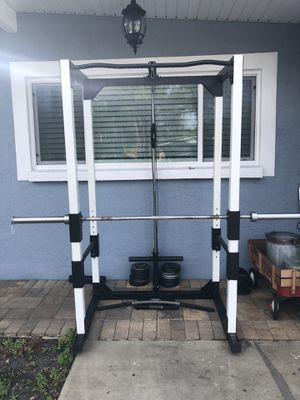 Full squat rack with high and low pulleys and pull up station with Olympic barbell for Sale in Tampa, FL