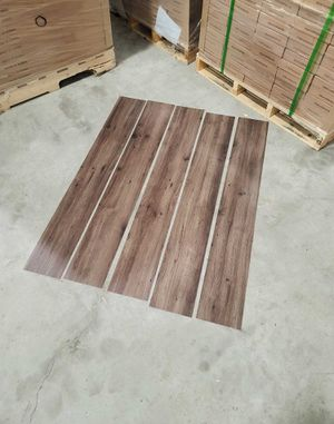 Luxury vinyl flooring!!! Only .65 cents a sq ft!! Liquidation close out! ZYT for Sale in Houston, TX