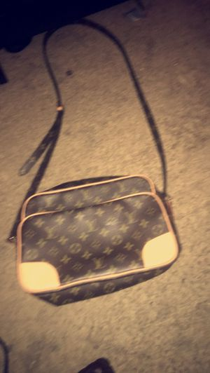 LOUIS VUITTON CROSS BODY BAG , BROWN TRADESY for Sale in Silver Spring, MD