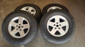 Jeep Wrangler wheel and tires for Sale in Everett, WA