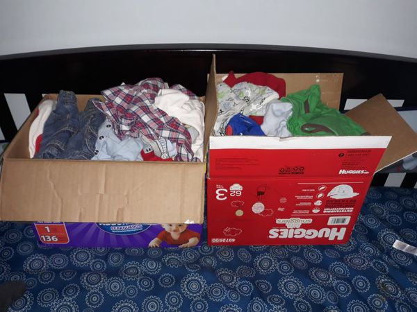 2 boxes of baby clothes