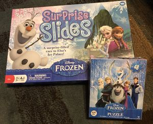 New frozen board game surprise slides and puzzle for Sale in Saint Charles, MO