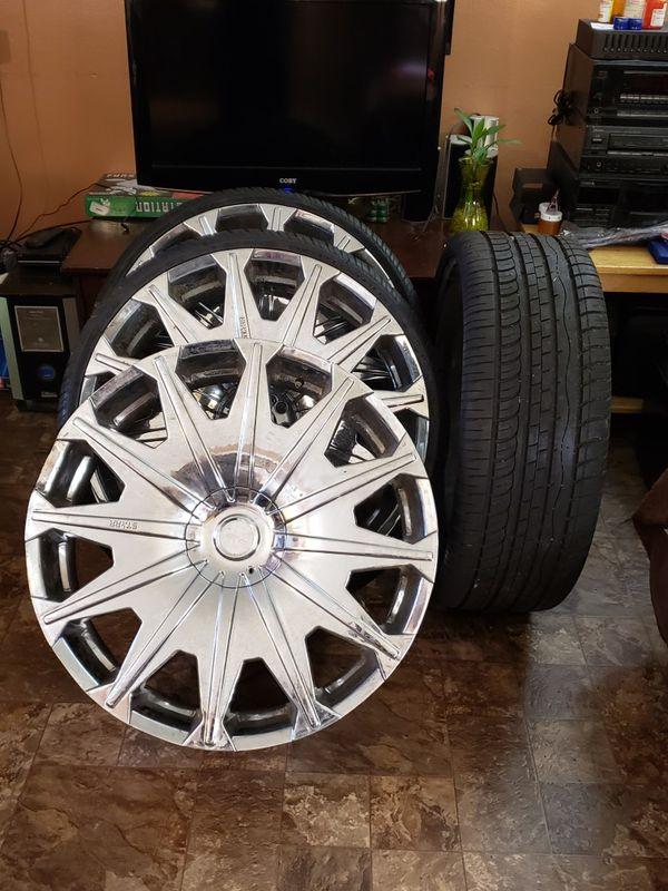 4 Chrome rims & 3 tires