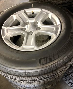 New 2019 Jeep Wrangler JL alloy wheels or JK OEM Rim's & Tires Michelin 245/75/17 for Sale in Anaheim, CA