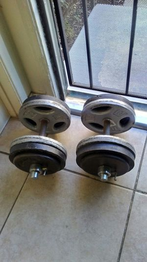 A pair of adjustable 50lb dumbbell weights (100Ibs) total. for Sale in El Cajon, CA