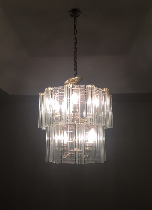 Elegant Crystal and Gold Chandelier and light bulbs fixture