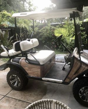 Golf cart with lifted tires newer batteries ezgo for Sale in Tampa, FL