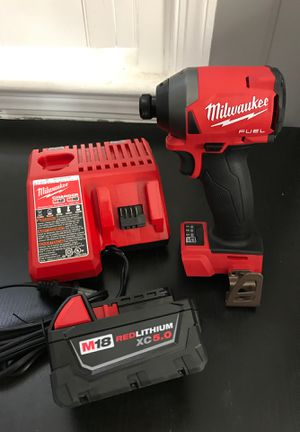 Milwaukee fuel impact kit with 5.0 battery for Sale in Arlington, VA