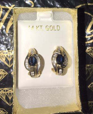14k Gold earrings with black diamond in the center and diamonds around it for Sale in Valrico, FL