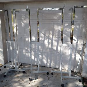 I have 3 high quality adjustable height direction rolling clothing racks excellent condition first 99 takes all 3 much better quality than the pict for Sale in Fort Myers, FL