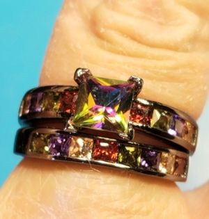 Multicolored Lab Sapphires and Mystic Solitaire Set in Black Electroplated Wedding Rings. for Sale in Amarillo, TX