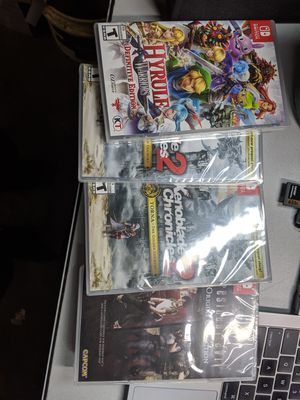 Hyrule warriors, Xenoblade expansion code, resident evil Nintendo switch game for Sale in Dallas, TX