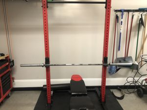 Rogue squat rack with bench, barbell and weights for Sale in Las Vegas, NV