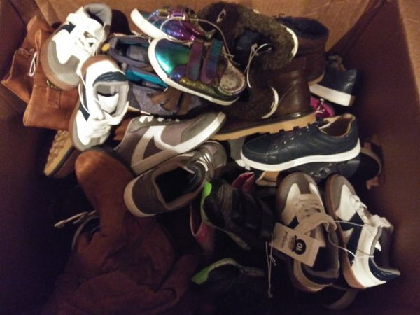 Two boxes with shoes almost a 100 pairs different sizes women man and kids shoes