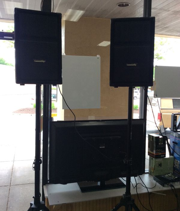System w/ Voco Pro Equalizer, 2 CD/DVD Players and QSC 2CH Audio Power Amp. 2 Community DnD12 750W Peak, 2-Way Loudspeakers w/Stage Stands