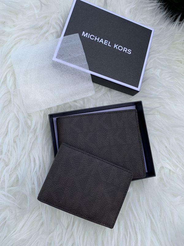 156531ce48a0 Michael Kors Men's Billfold W/Passcase Wallet for Sale in Arlington ...