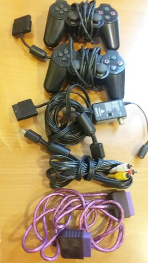 2 CONTROLERS SONY PLAYSTATION WITH EXTRA CABLES $14 FOR ALL for Sale in Alexandria, VA