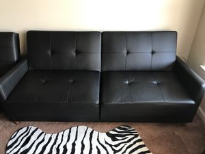 Like new tufted black faux leather sofa couch futon for Sale in Centreville, VA