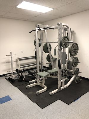 Smith Machine Pulldown and universal home gym system with weights by Hoist for Sale in University Place, WA