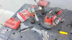 brush less Milwaukee impact and drill and band sawcams with 3 blades 3 baterys for Sale in Modesto, CA