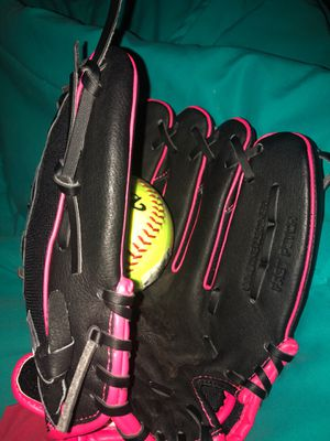 Black and pink softball mitt with brand new softball for Sale in North Las Vegas, NV