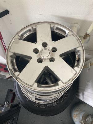 Jeep wheels 5 2 with good tires 3 just rim for Sale in Orlando, FL