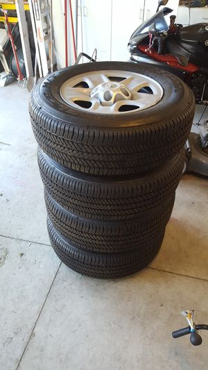 4 Bridgestone Dueler H/T Tires and Wheels 255/70/R18 for Sale in Riverside, CA