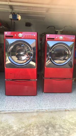 Kenmore elite ruby red washer and gas dryer with pedestals and drying rack for Sale in Windermere, FL