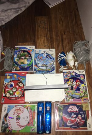 Wii comes with all wires 6 games 2 handles an 2 nunchucks for Sale in Alexandria, VA