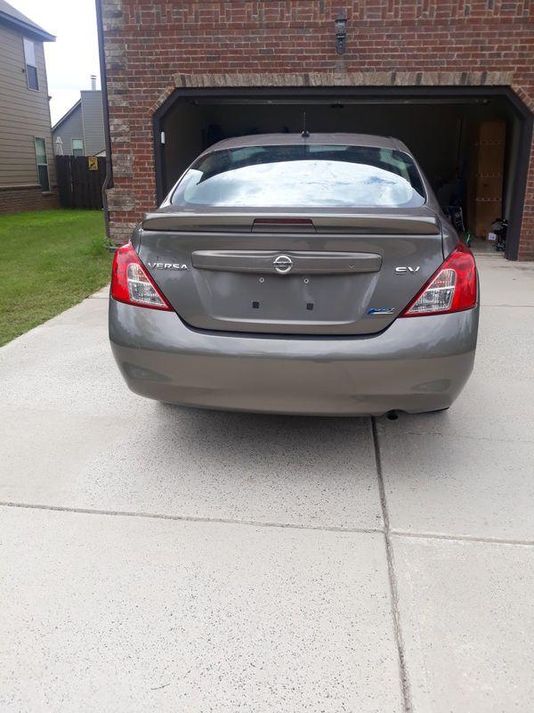 2013 Nissan versa, auto, 98kmiles, Pass Emissions,cold AC, AUX/ USB, Gas saver, 6CD charger, clean ,