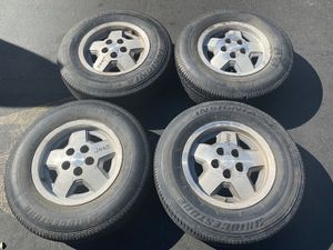 """(4) 15"""" Jeep Wheels + 215/75R15 tires - $250 for Sale in Santa Ana, CA"""