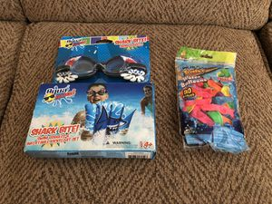 New shark goggles with inflatable kick board Includes water balloons for Sale in O'Fallon, MO