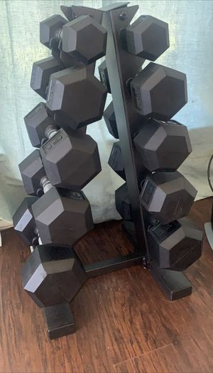 Dumbbell set. 5-25 pairs. Rubber coated. Like new. for Sale in Bedford, TX