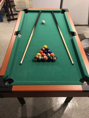 4 ft pool table for children!! Pool balls and sticks!! for Sale in Bridgeport, CT