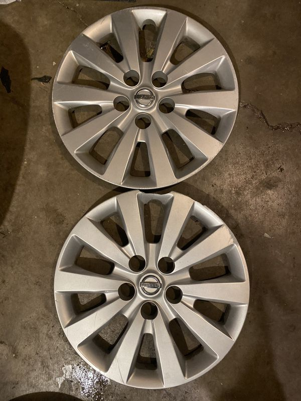 Two 16'' Nissan hubcaps