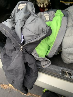 7-8 year old winter jacket and lands end overalls and Levi's and clothes for Sale in Milwaukee, WI
