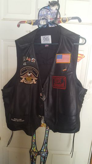 Leather motorcycle vest with pins and patches for Sale in Temple, GA
