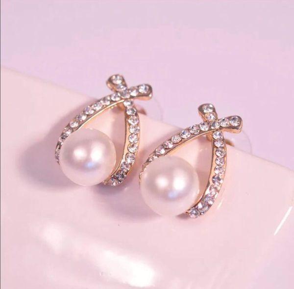 Pearl and Crystal Stud Earrings.