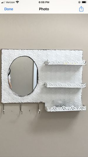 Wall mirror with three shelves and hooks. Distressed and darling for Sale in San Diego, CA