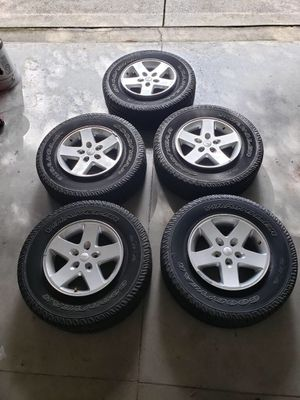 Jeep Wrangler wheels and tires for Sale in St. Petersburg, FL