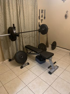 Adjustable weight bench with two adjustable racks and curved curl bar for Sale in Winter Haven, FL