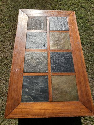 Rolling tile top coffee table with rack for Sale in Abilene, TX