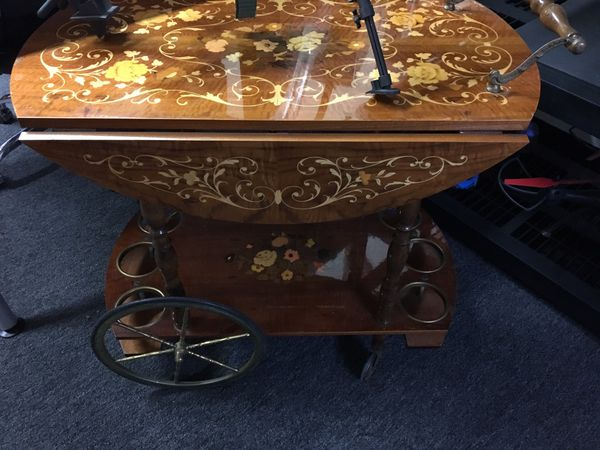 Antique table with wheels
