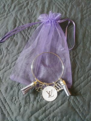 Gold plated bracelet with designer charm. for Sale in High Point, NC