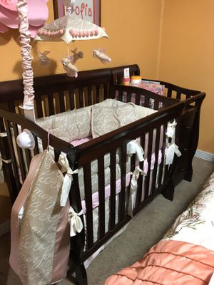 Brown wood mini crib for Sale in Chesapeake, VA