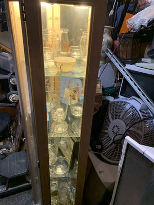 Display curio don't no the measurements the vintage glass is for sale as well in the curio for Sale in Las Vegas, NV